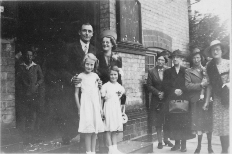 Wedding of Cissie Florence Stevens to Henry Charles Asplen outside Romsey Town Methodist Church, 1941.