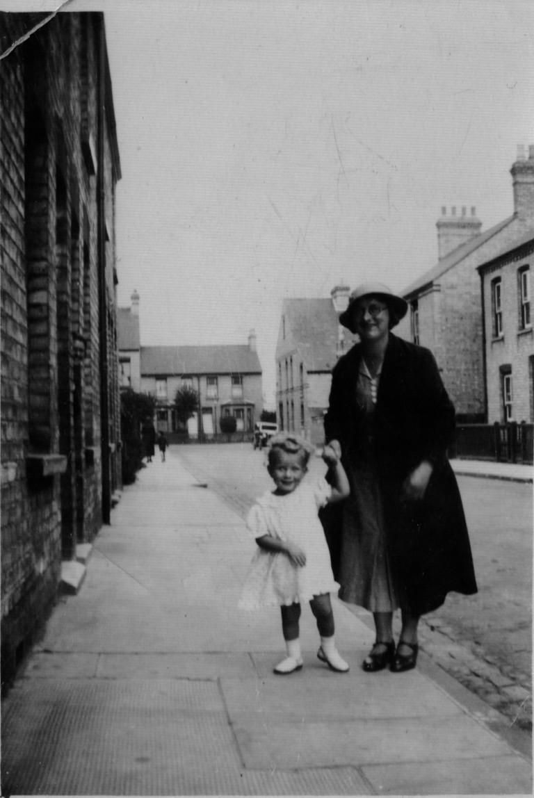 Dorothy Stevens with a child relation outside 18 Cyprus Road, c.1950