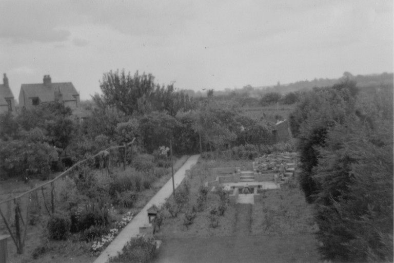 Garden at 58 Natal Road in 1953 showing new pond and rockery. Houses to the left are in Burnside.