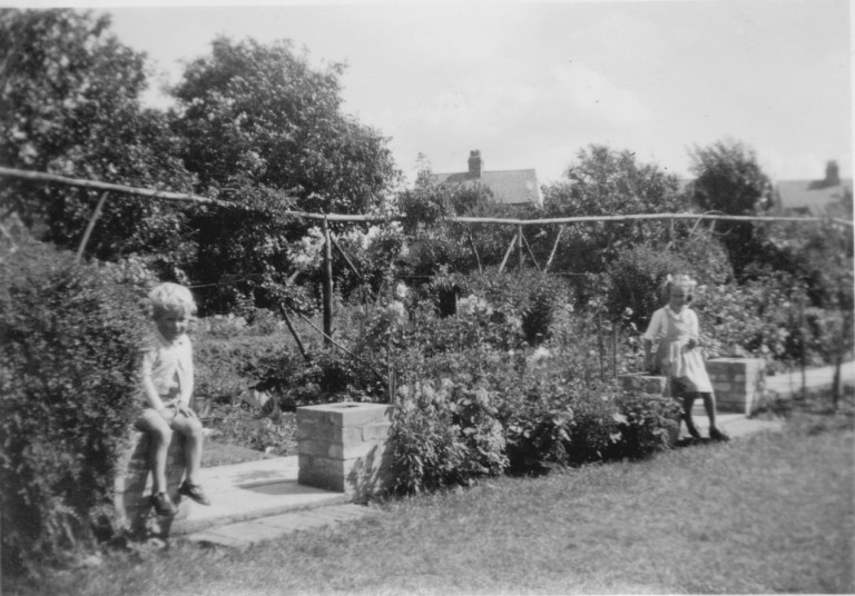 Colin Gordon Fakes and Susan Brenda Fakes in the garden of 58 Natal Road Cambridge in 1950