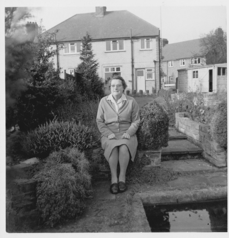 Ida Fakes (née Stevens) sitting near the pond in the garden at 58 Natal Road in 1968