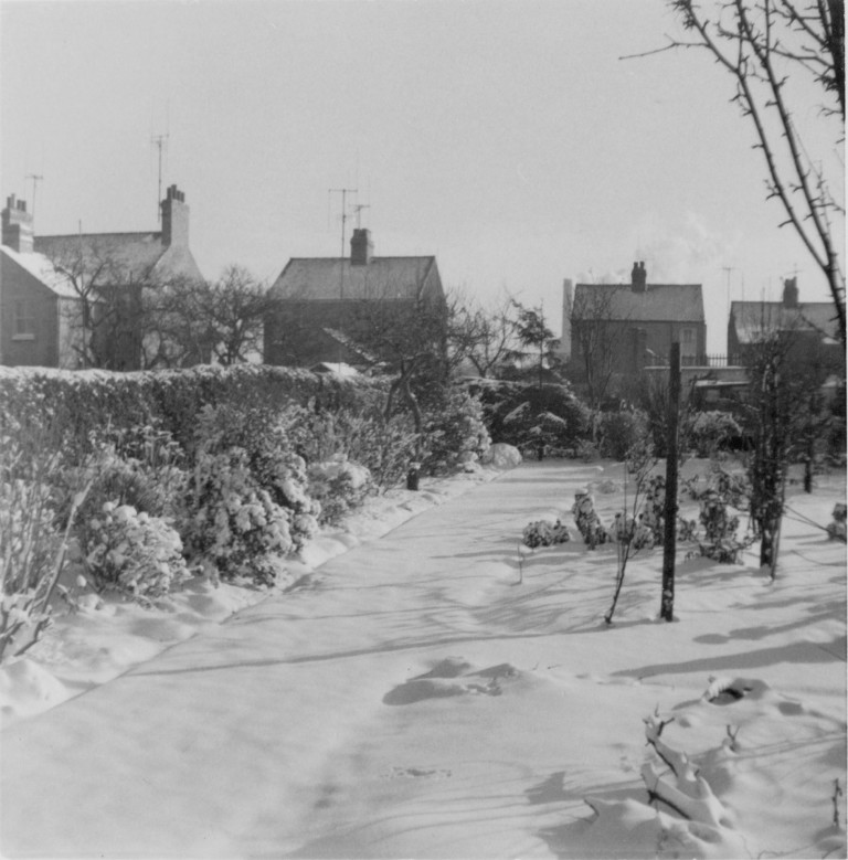 Snowy scene of 58 Natal Road with the Cement Works chimney in the background, winter 1962.