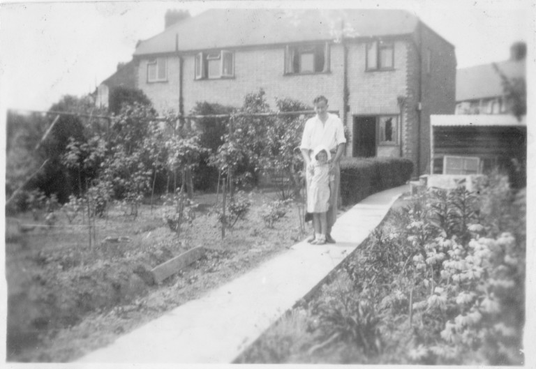 Gordon Fakes with Marion Ida Fakes in the garden of 58 Natal Road, c.1941