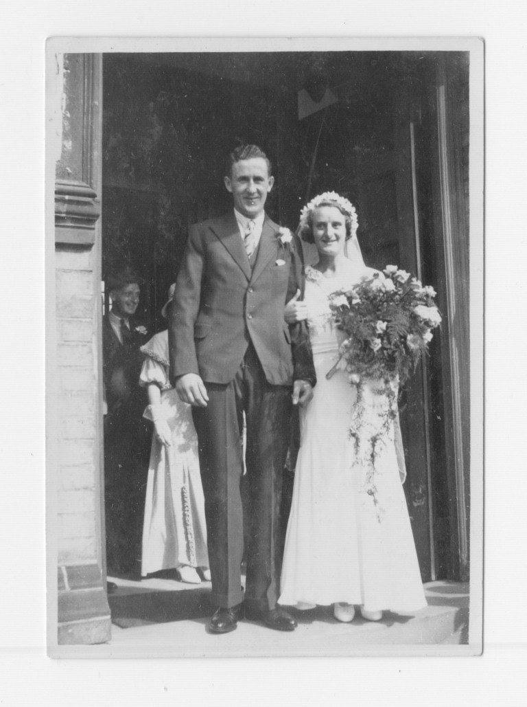 Ida Stevens marrying Gordon Fakes at Romsey Town Methodist Church, 1934. Albert William Stevens in background.
